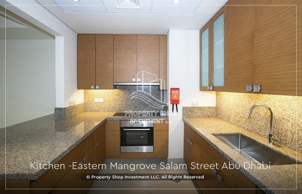 Kitchen - Elegant, Stunning 1BR Apartment with Mangrove View, Pool, Gym