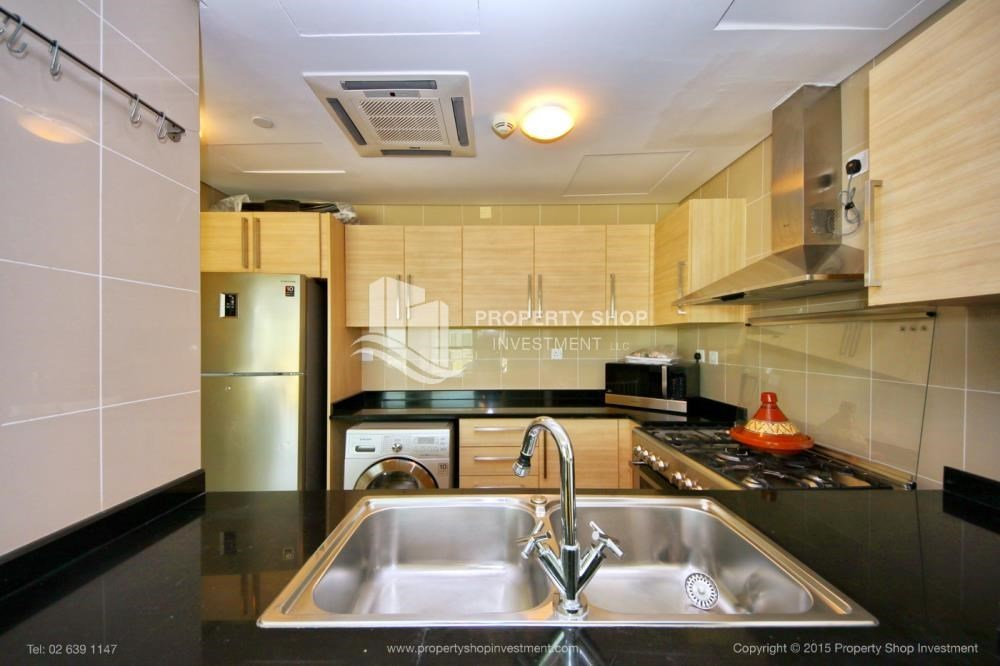 Kitchen - Stunning 1BR in High Floor with panoramic views of Al Reem community.