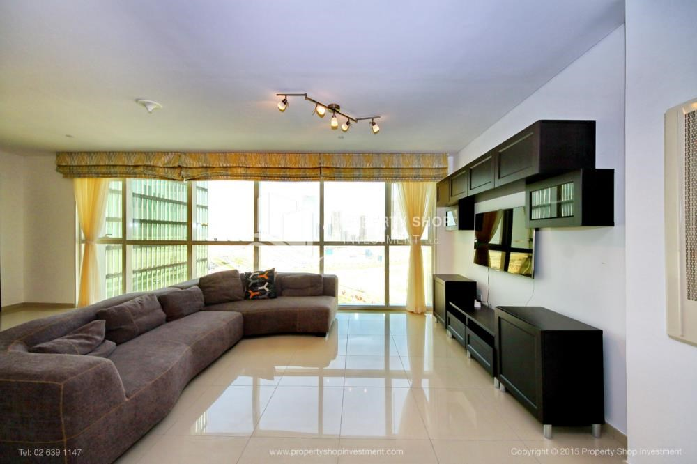Living Room - Stunning 1BR in High Floor with panoramic views of Al Reem community.
