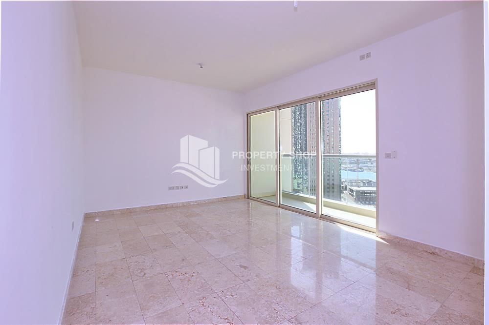 Living Room - High floor 2BR unit with balcony plus partial sea view.