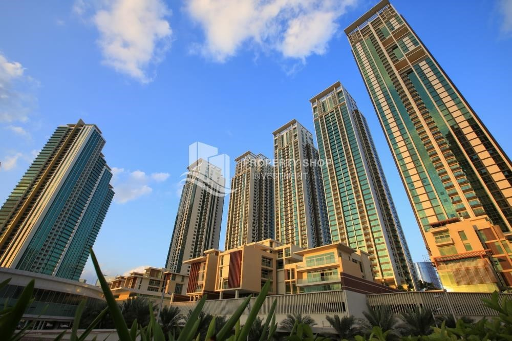 Property - High floor 2BR unit with balcony plus partial sea view.