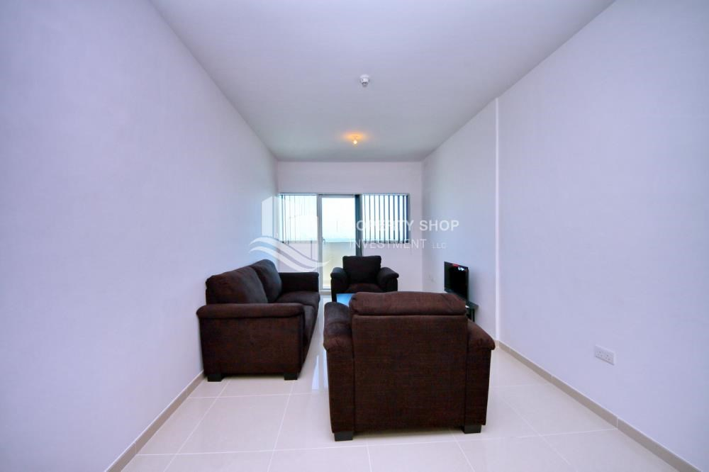 Living Room - Sea-city view 1BR apt w/ built in cabinet for sale in Marina Bay.