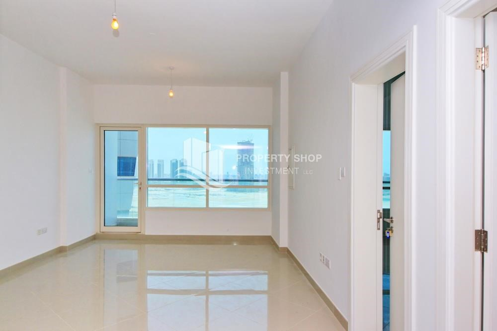 Living Room - High floor 1BR Apt with Luxury Facilities.