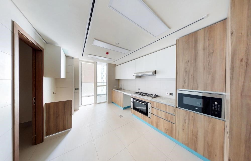 Kitchen -  3BR  with spacious balconies overlooking Al Reem Park and mangroves.
