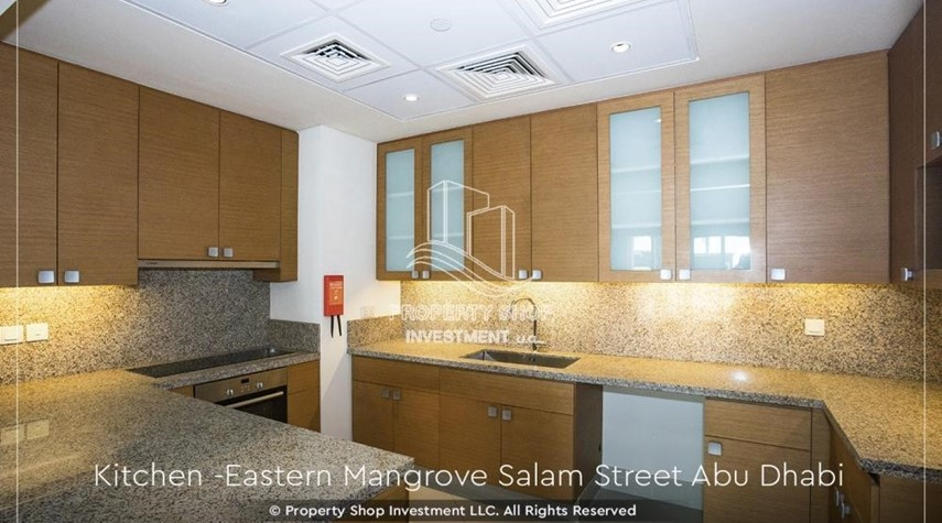 Kitchen-Elegant, Stunning 1BR Apartment with Mangrove View, Pool, Gym