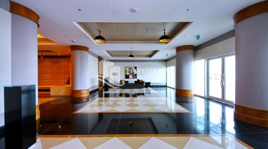 Lobby-Sea-city view 1BR apt w/ built in cabinet for sale in Marina Bay.