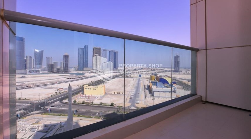 Balcony-High floor Apt in Al Maha Tower.