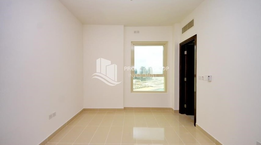 Bedroom-High floor Apt in Al Maha Tower.