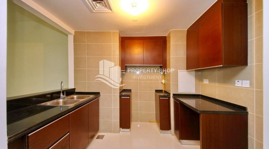 Kitchen-High floor Apt in Al Maha Tower.