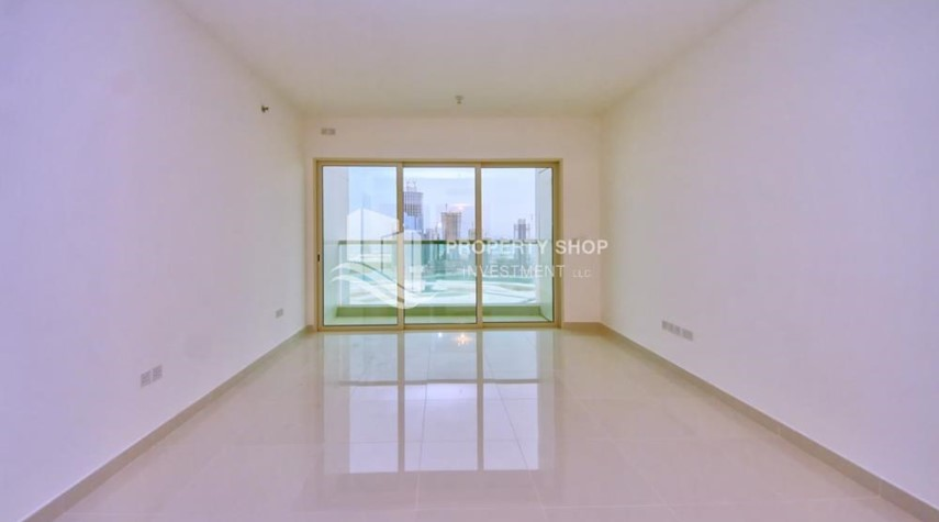 Living Room-High floor Apt in Al Maha Tower.