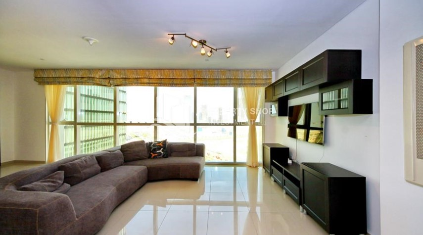 Living Room-Stunning 1BR in High Floor with panoramic views of Al Reem community.