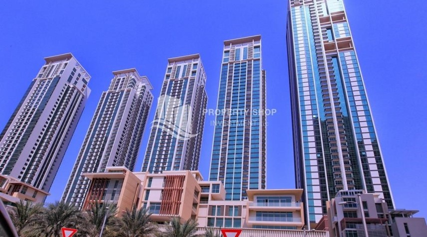 Community-High floor 2BR unit with balcony plus partial sea view.