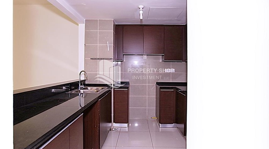 Kitchen-High floor 2BR unit with balcony plus partial sea view.