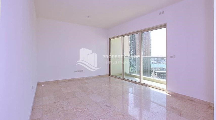 Living Room-High floor 2BR unit with balcony plus partial sea view.
