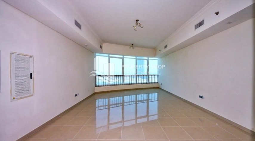 Living Room-Mid Floor Unit with Sea View + Parking.