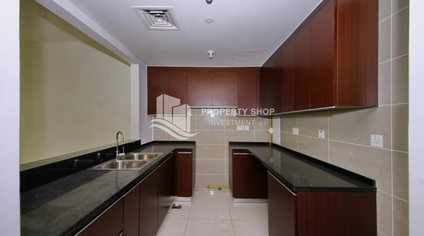 Kitchen-Vacant 1BR Apt, High floor  with Balcony + Walk-in Closet.