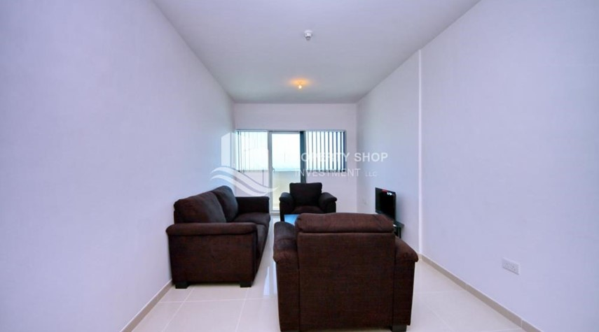 Living Room-Sea-city view 1BR apt w/ built in cabinet for sale in Marina Bay.
