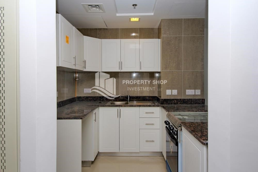 Kitchen-High floor 1BR Apt with Luxury Facilities.