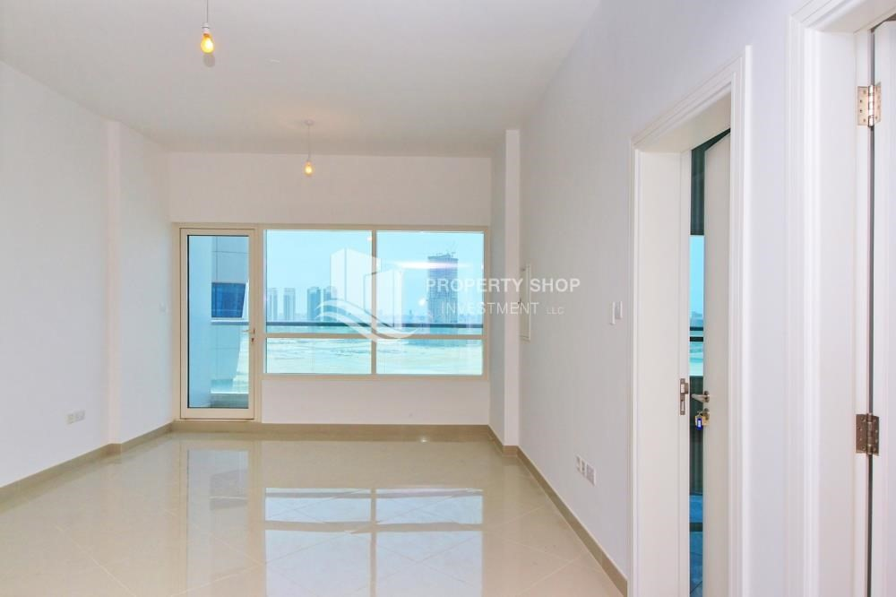 Living Room-High floor 1BR Apt with Luxury Facilities.