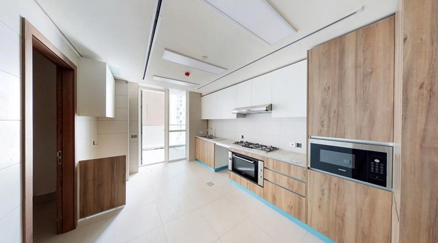 Kitchen- 3BR  with spacious balconies overlooking Al Reem Park and mangroves.