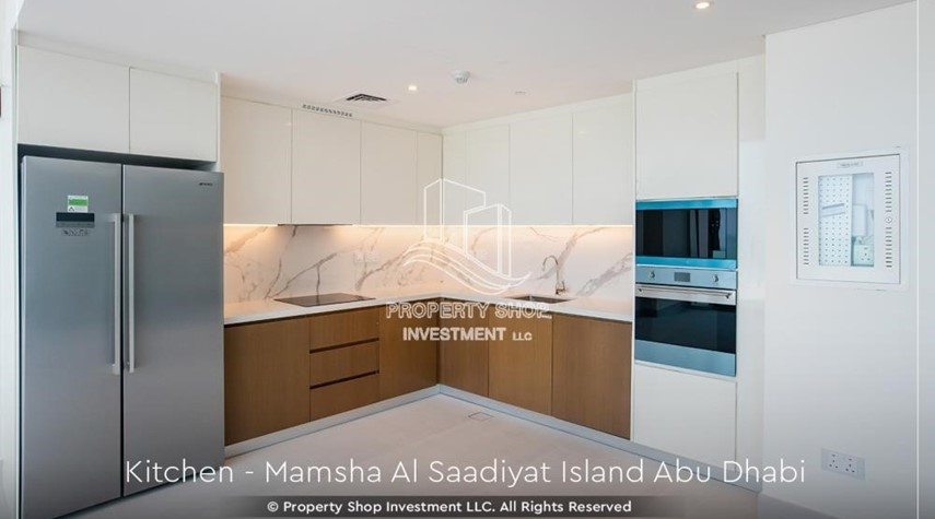 Kitchen-1br loft in a beach front community. book now!
