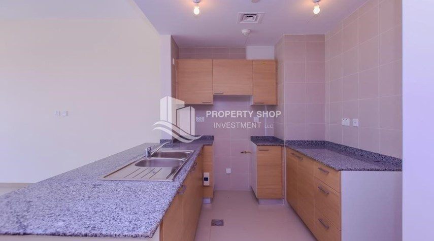 Kitchen-Vacant 1BR Apt on mid-floor with full facilities.