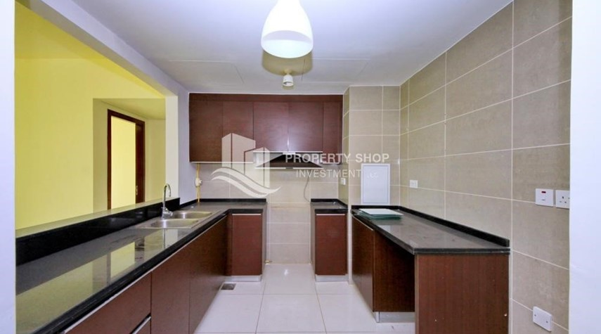 Kitchen-High floor 2BR Apt with sea view.